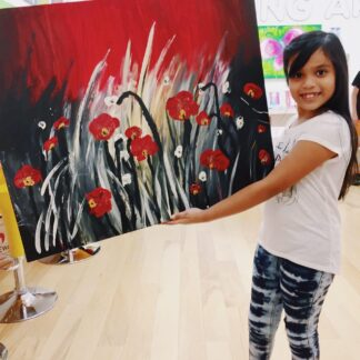 image of student holding artwork of flowers