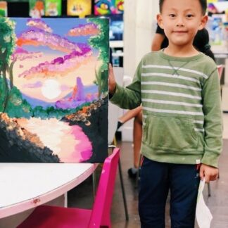 image of student holding artwork of scenery