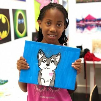 student showing art puppy