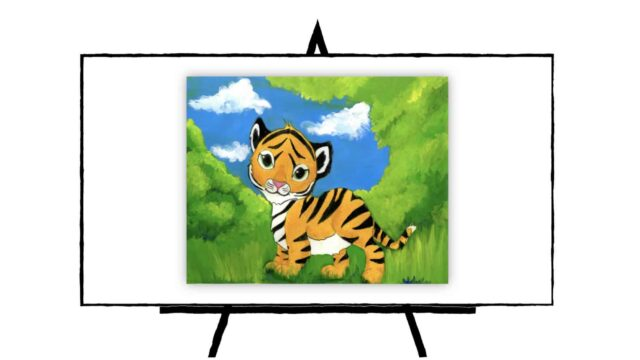 Baby Tiger In lush green jungle with blue sky and white clouds