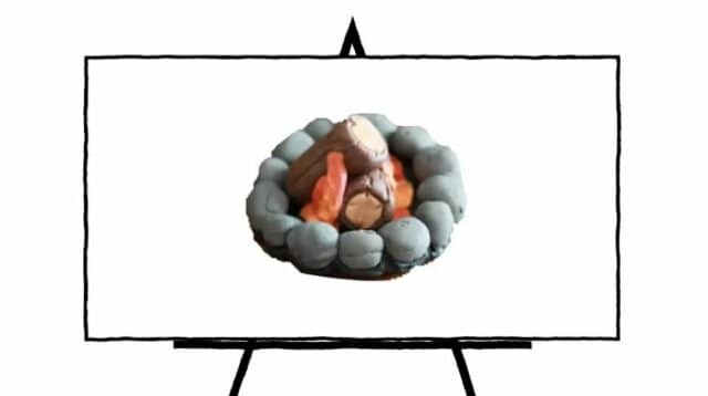 3d sculpture of camp fire with clay in grey rocks and orange fire with brown logs