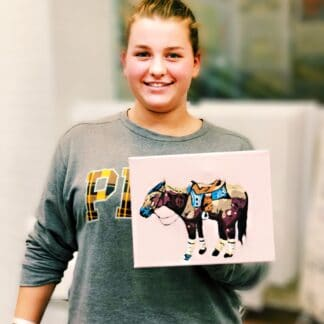 girl holding painting of a horse
