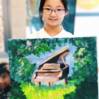 a girl holding her painting of a piano