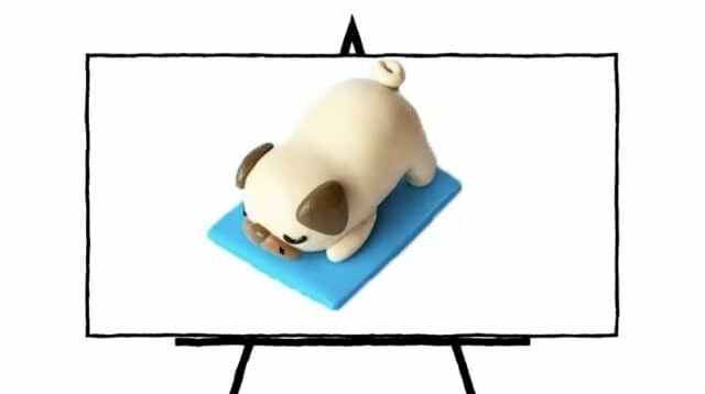 image of a pug made of clay laying on blue mat