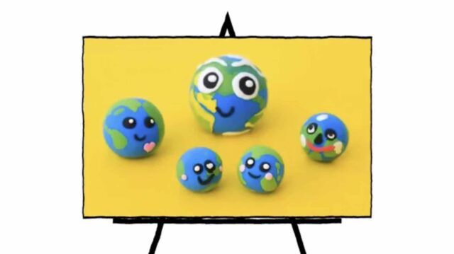 image of five clay sculpted 3d rounded shapes with green and blue and faces