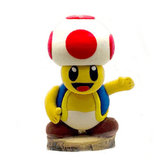 toad character clay sculpture